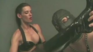 Alex Foxe is a stern dominatrix that specializes i